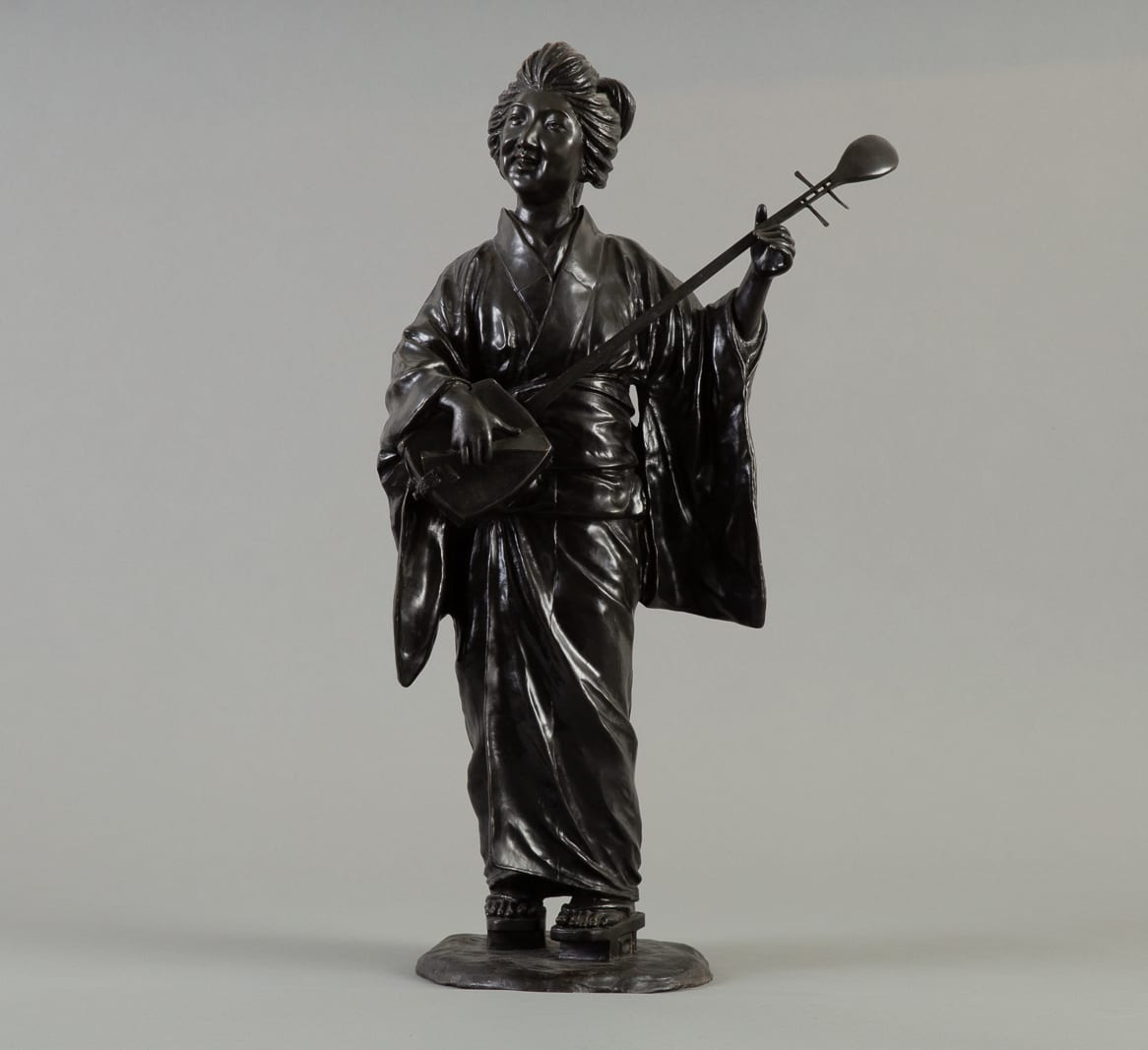 Lot 010: Japanese Meiji Bronze Geisha Okimono Signed