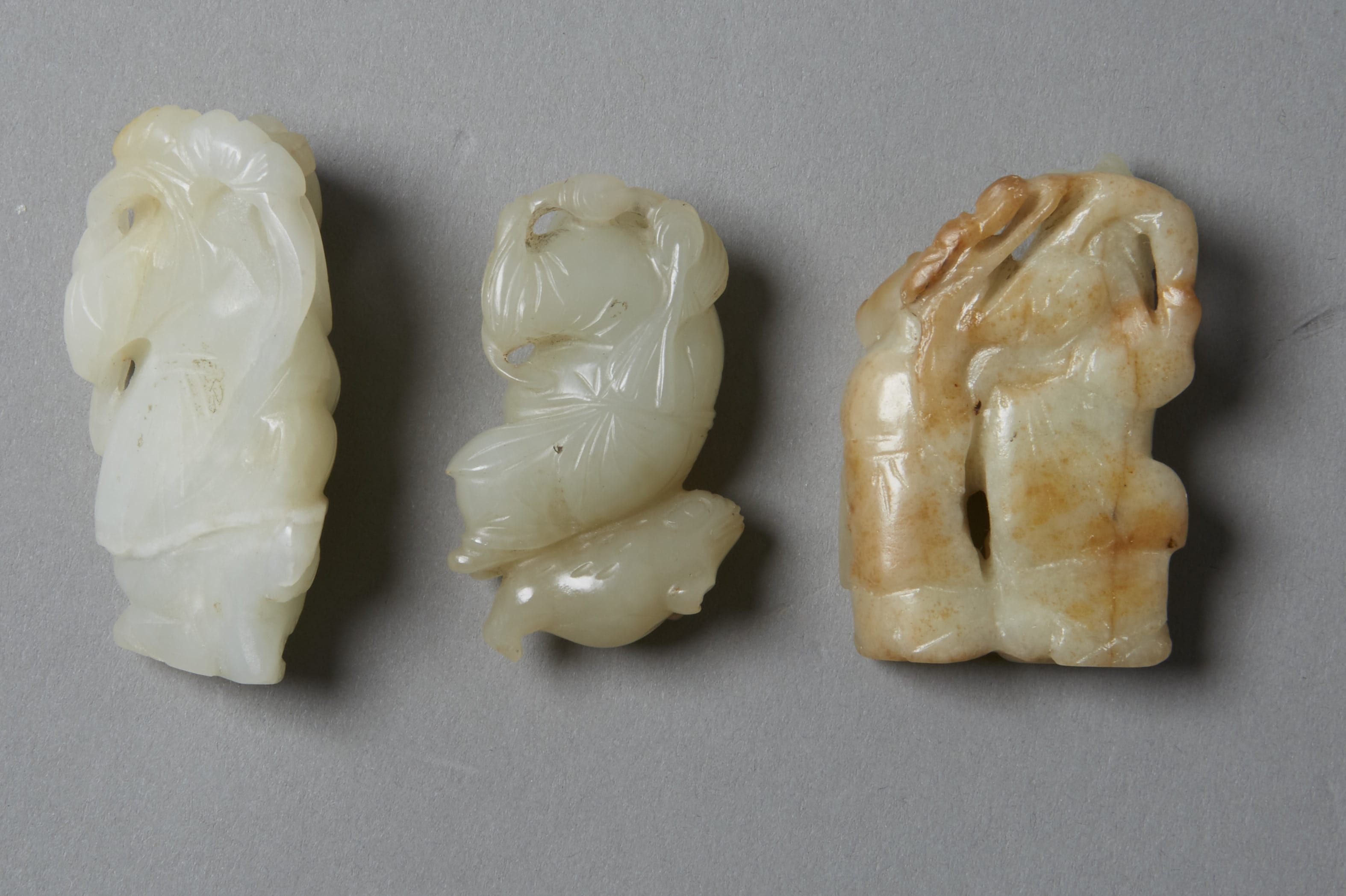 Lot 016: Group of 3:  19th century Chinese Jade Carved Figures
