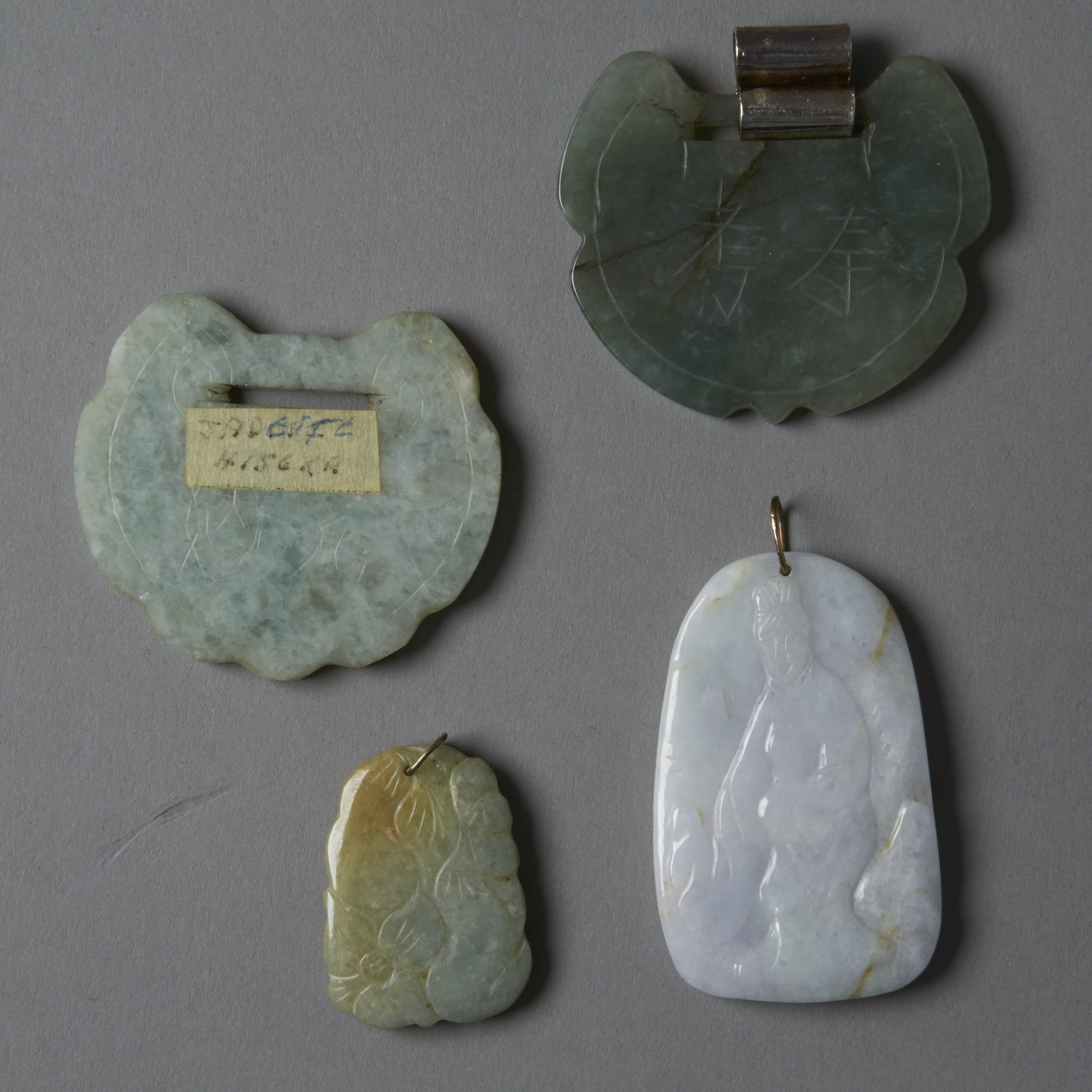 Lot 018: Group of 4: 20th century Chinese white and green carved Jade Pendants