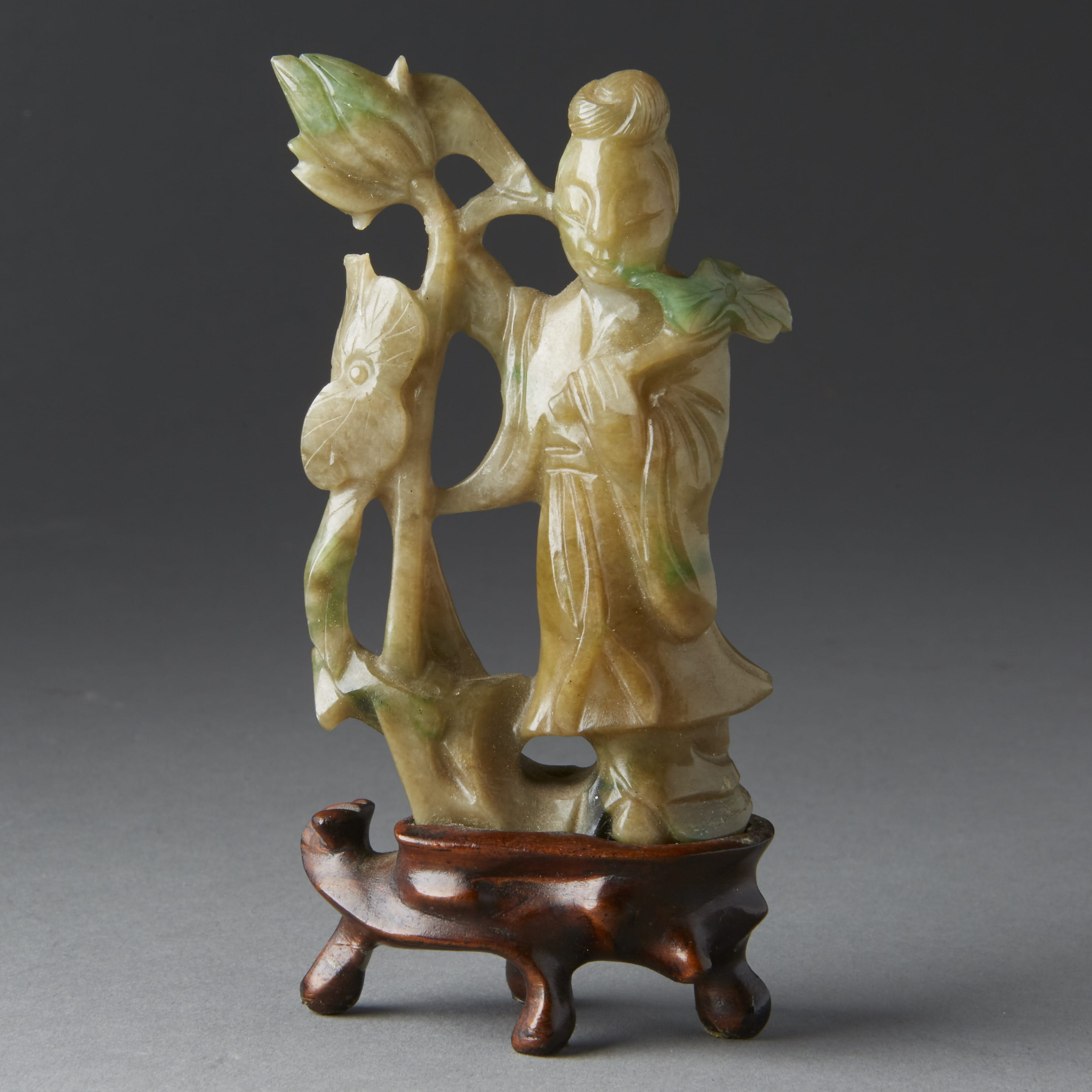 Lot 025: Chinese 19th century green jade carving of maiden on wooden stand